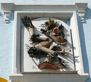 Изображение беса на фасаде бывшей Духосошественской церкви (Казань)