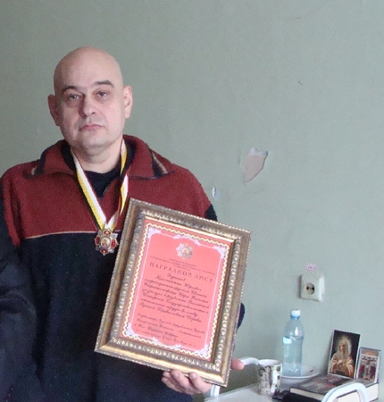 К.Душенов с орденом Святого Царя Николая в Ириновской больнице под СПб.